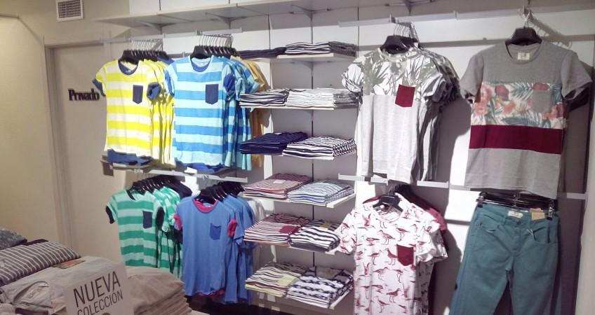 Estantes y percheros en cremallera de pared para tienda de moda masculina Celopman Lucena